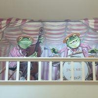 In this commission the clients wanted something to fill an architectural oddity of their breakfast room, a shelf over the ceiling of an adjoining utility room. I came up with a minstrels gallery with a frog jazz quartet. The medium is acrylic on to emulsion on plaster. Plus MDF cut-outs. Completed June 2007.
